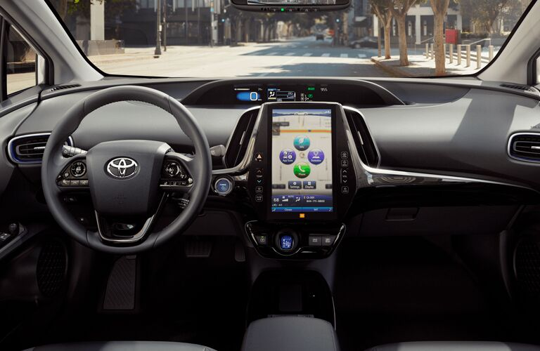 front interior of 2019 toyota prius including steering wheel and infotainment system