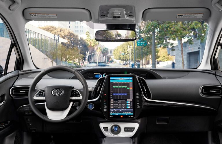front interior of 2019 toyota prius prime including steering wheel and infotainment system