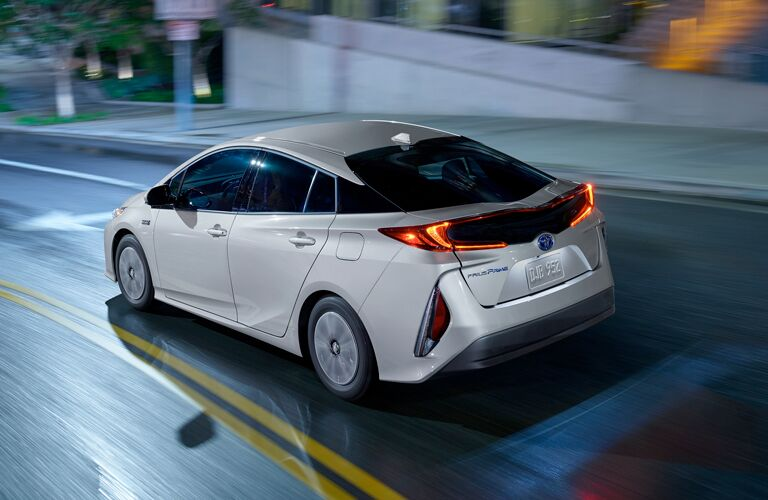 rear and side view of white 2019 toyota prius prime