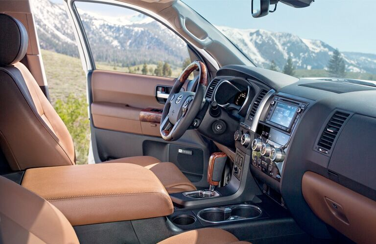 side view of front interior of 2019 toyota sequoia including steering wheel and center console