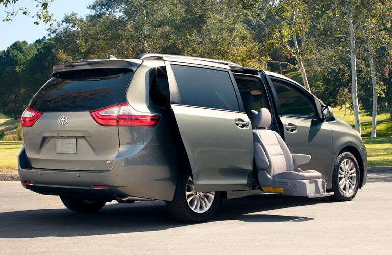 rear and side view of 2019 toyota sienna with cargo doors open and handicap accessible chair
