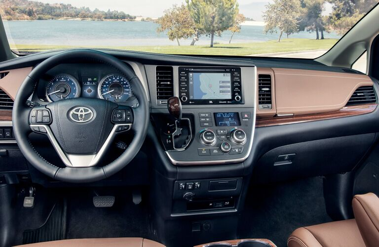front interior of 2019 toyota sienna including steering wheel and center infotainment system