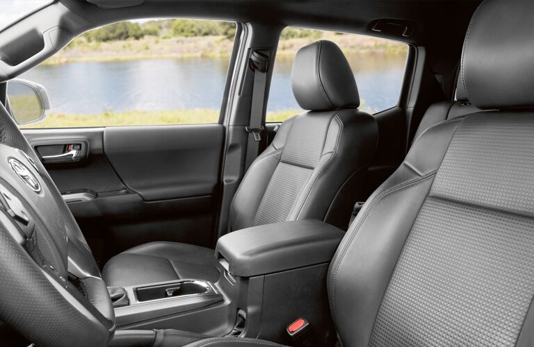 side view of front interior of 2019 toyota tacoma including seats and center console
