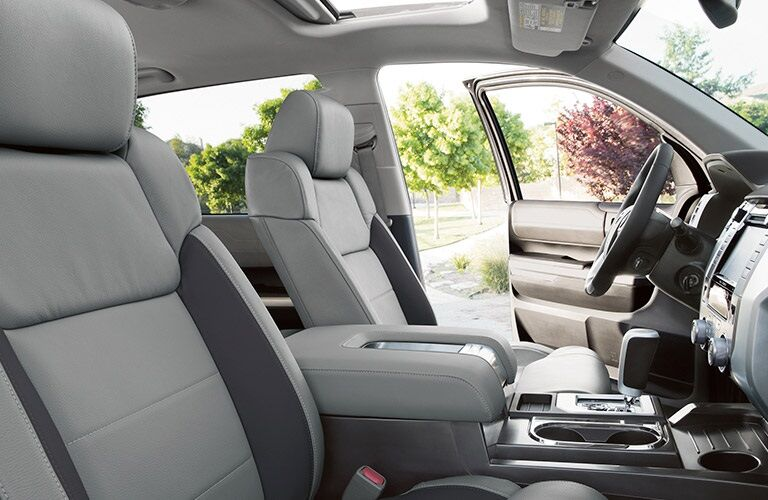 side view of front interior of 2019 toyota tundra including steering wheel and center console