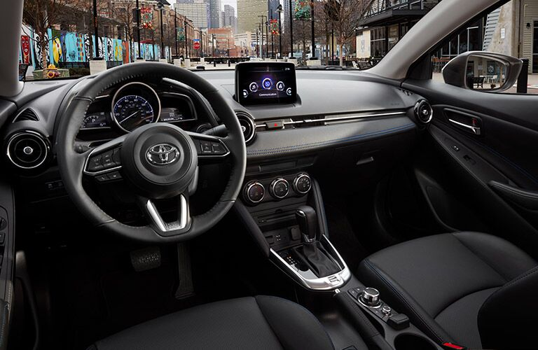 front interior of 2019 toyota yaris including steering wheel and infotainment system