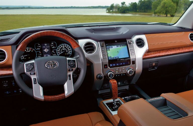 front interior dashboard of 2019 toyota tundra with wood trim and tan leather seats
