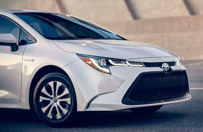 front end of white 2020 toyota corolla hybrid