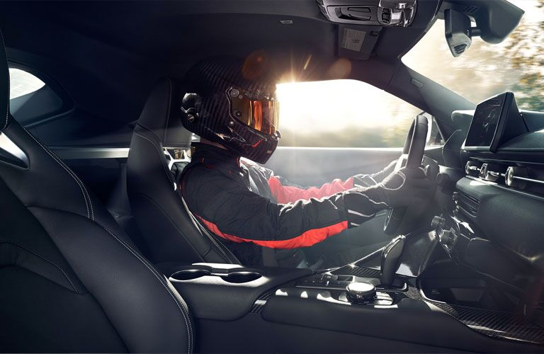 2020 Toyota GR Supra front interior with driver behind the wheel