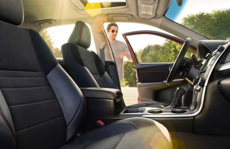 Man oping driver door of 2017 Toyota Camry