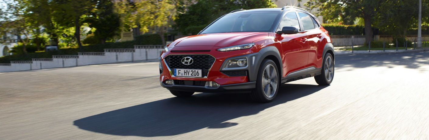 Front exterior view of a red 2018 Hyundai Kona
