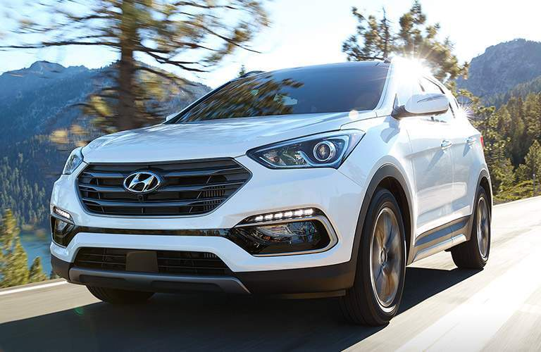 Front exterior view of a white 2018 Hyundai Santa Fe