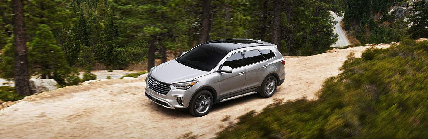 2018 Hyundai Santa Fe silver side view on a mountain road