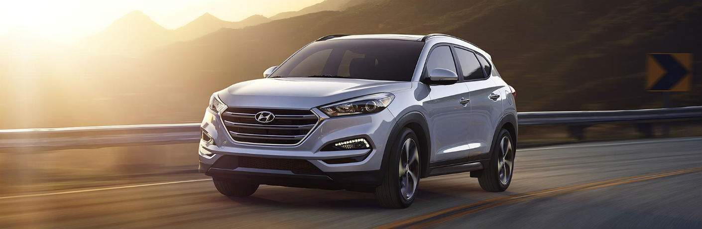 Front exterior view of a gray 2018 Hyundai Tucson