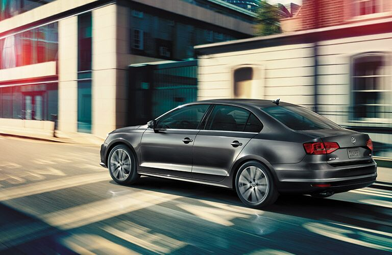 2016 vw jetta driving down a city road