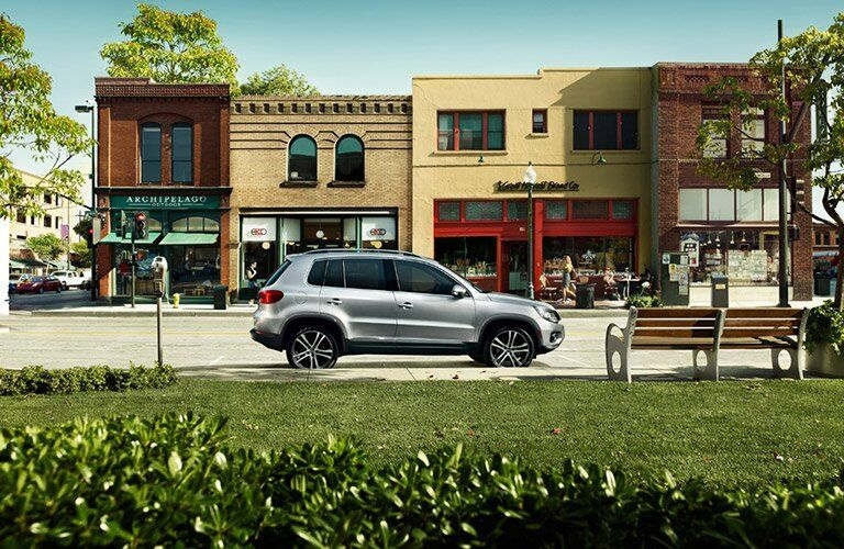 2017 Volkswagen Tiguan parked in front of new shops