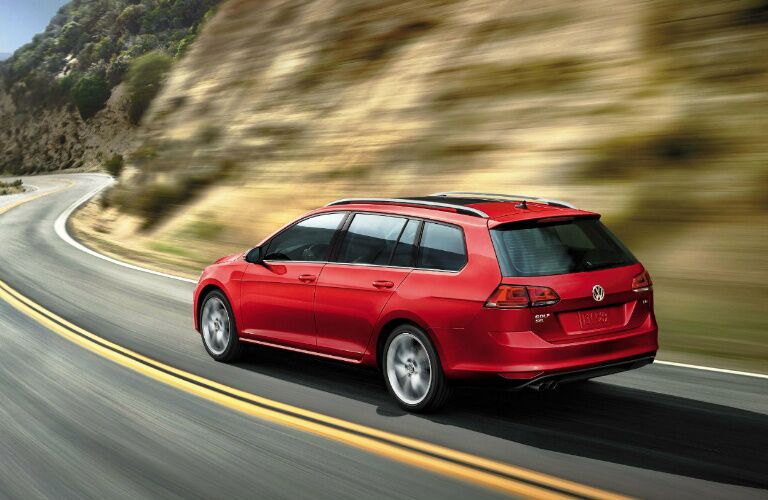 vw golf sportwagen on curvy road