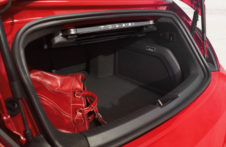Red Bag in the Trunk of a 2018 Volkswagen Beetle Convertible