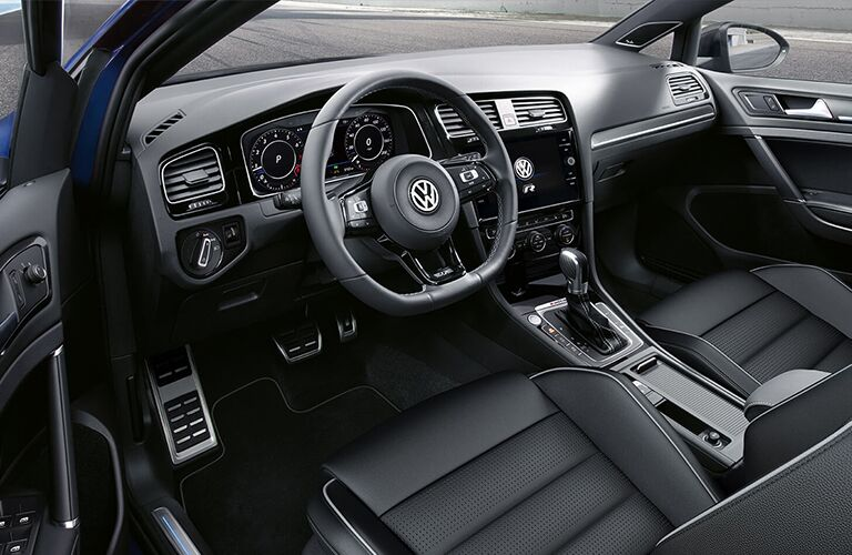 Dashboard and dark grey front seats in 2019 Volkswagen Golf R
