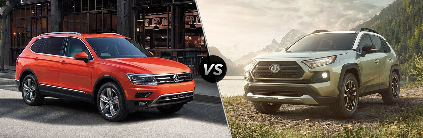 Orange 2019 Volkswagen Tiguan, VS icon, and grey 2019 Toyota RAV4