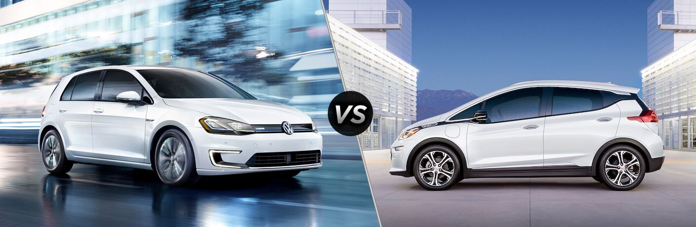 White 2019 Volkswagen e-Golf, VS icon, and white 2019 Chevrolet Bolt EV