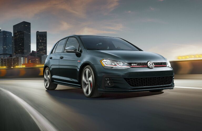 Grey 2020 Volkswagen Golf GTI with a city skyline in the background