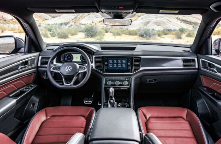 Dashboard and red and grey front seats in 2020 Volkswagen Atlas Cross Sport