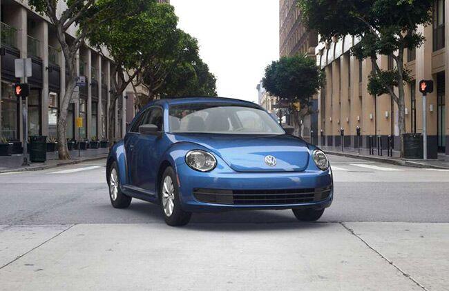 2016 VW Beetle Blue Parked