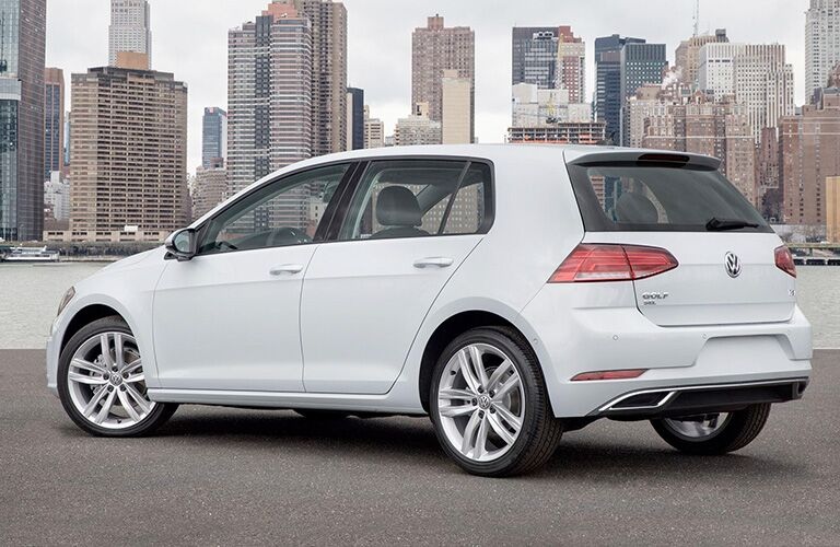 White 2018 Volkswagen Golf and City Skyline in the Background