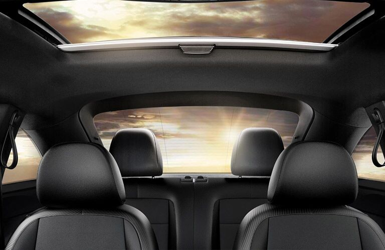 Grey Seats of 2018 Volkswagen Beetle and Sun Shining Through the Rear Window