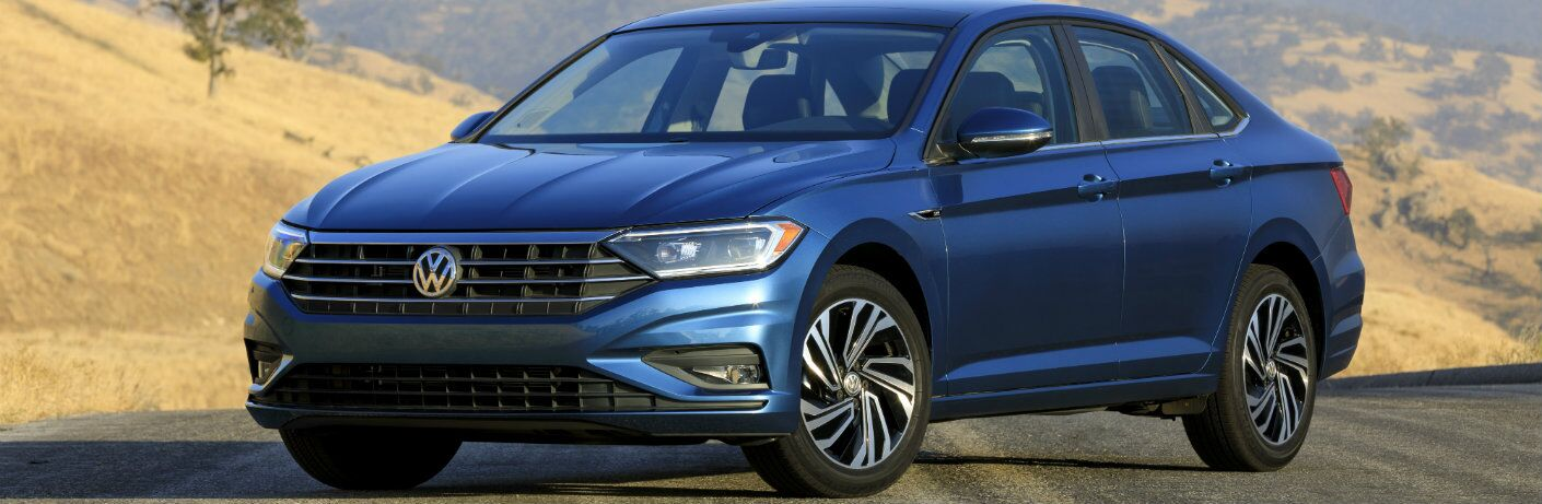 Blue 2019 Volkswagen Jetta with a Hilly Landscape in the Background