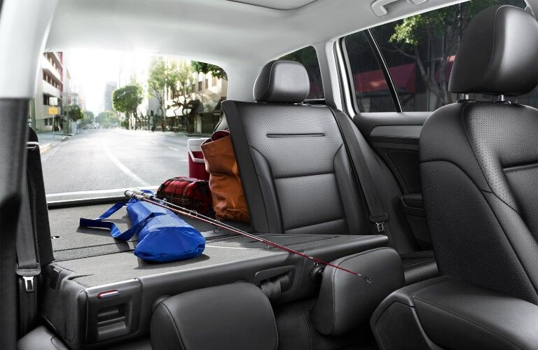 Front passenger seat angle of a rear seat put down with belongings in the back of the 2019 Volkswagen Golf SportWagen