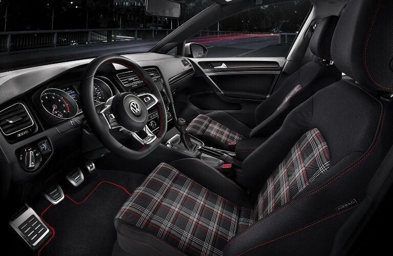 Dashboard and plaid front seats in 2019 Volkswagen Golf GTI