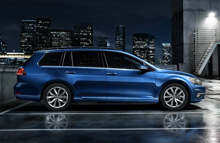 Blue 2019 Volkswagen Golf SportWagen with a city skyline in the background