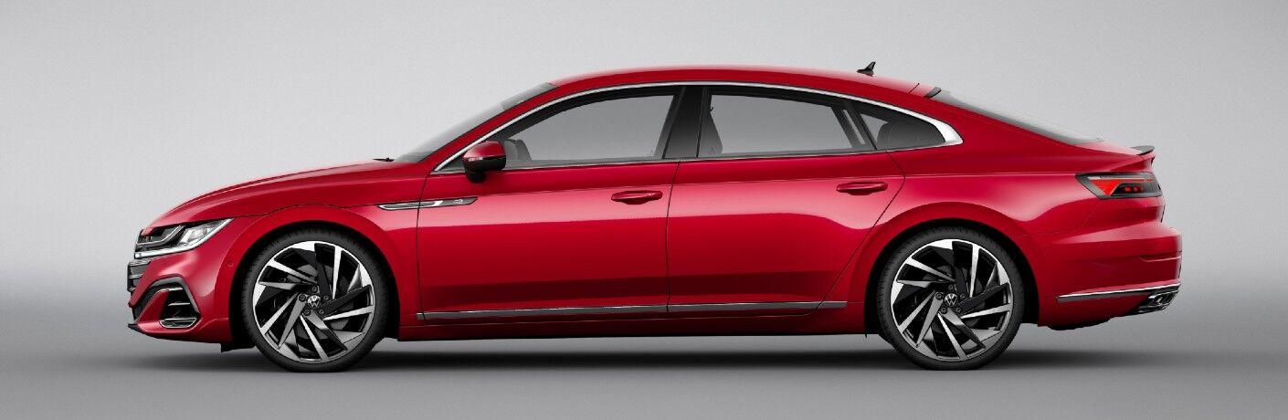 Side view of red 2021 Volkswagen Arteon