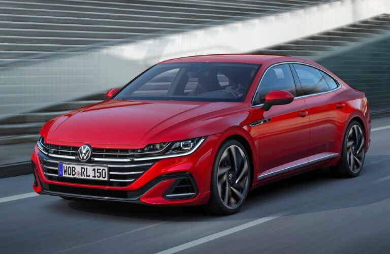 Driver's side front angle view of red 2021 Volkswagen Arteon