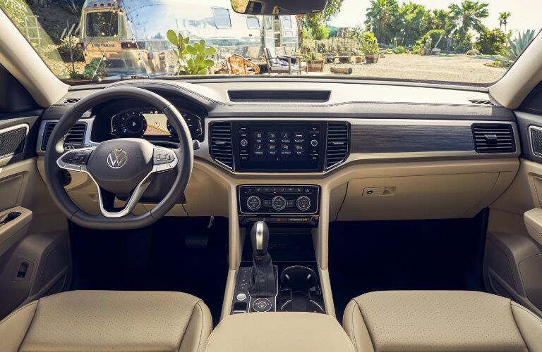 Grey and tan dashboard and tan front seats in 2021 Volkswagen Atlas