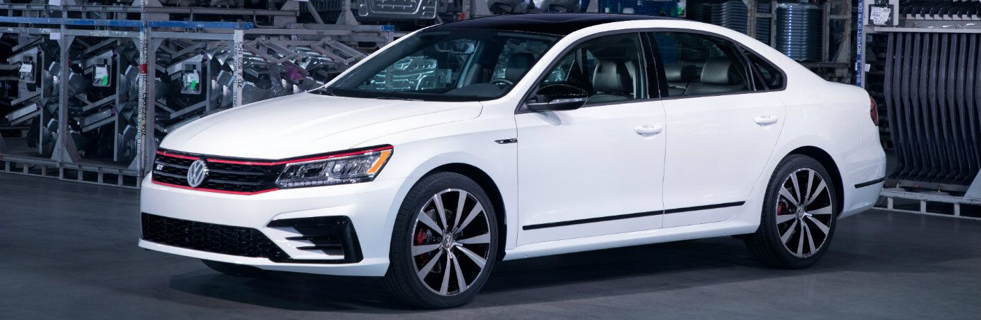 2018 Volkswagen GT exterior shot with white paint job parked in a warehouse full of machine parts