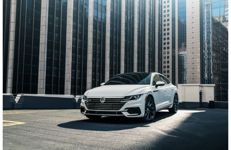 2019 Volkswagen Arteon R-Line exterior shot with white paint color parked on a city rooftop