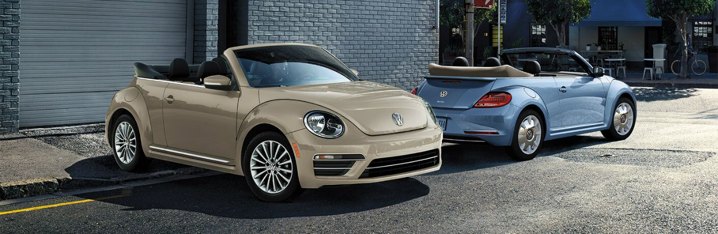 2019 Volkswagen Beetle Final Edition Convertible models exterior shot with new beige and blue colors parked outside a blue brick building