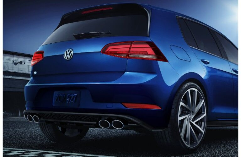 2019 Volkswagen Golf R exterior rear shot with blue pain color of trunk, taillights, and exhaust pipes