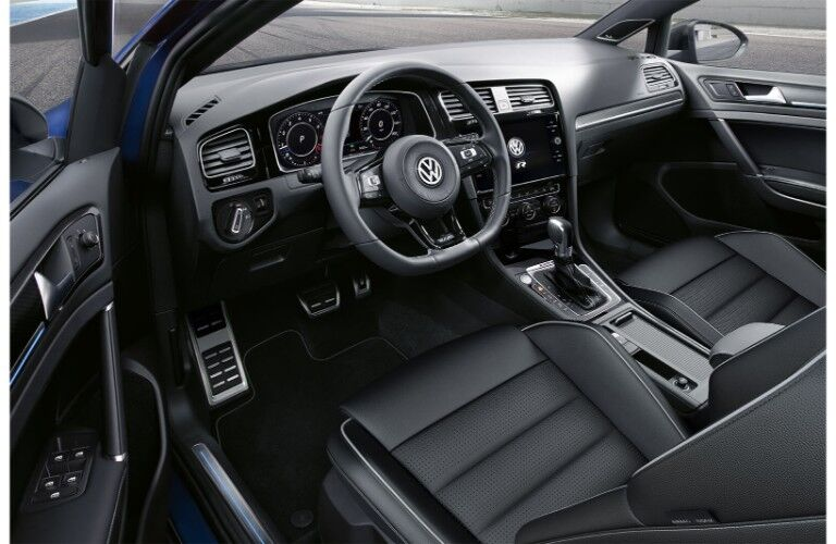 2019 Volkswagen Golf R interior shot of front seating upholstery, dashboard layout, and steering wheel