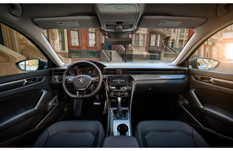 2020 Volkswagen Passat interior shot of front seating, dashboard layout, transmission, and steering wheel