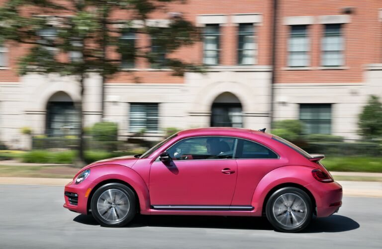 2017 Volkswagen pink beetle driving on the street