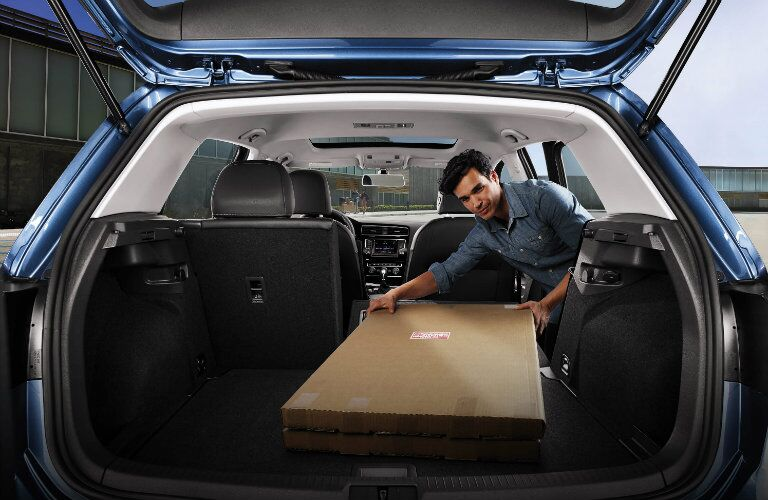 loading cargo into the 2017 vw golf with rear seats down