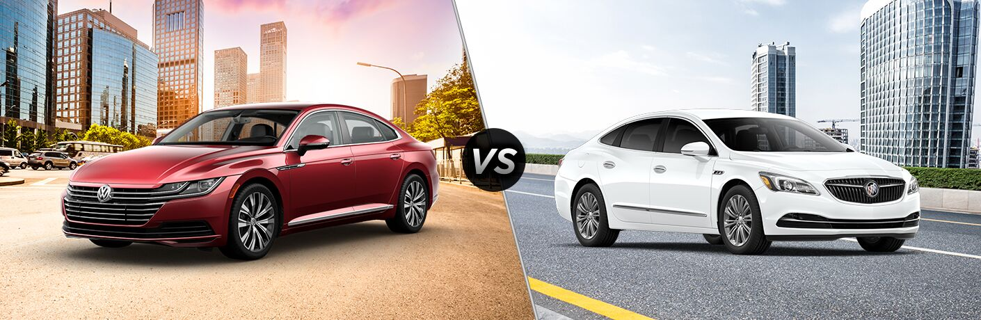 2019 VW Arteon exterior front fascia and driver side in front of city vs 2019 Buick LaCrosse exterior front fascia and passenger side in front of city
