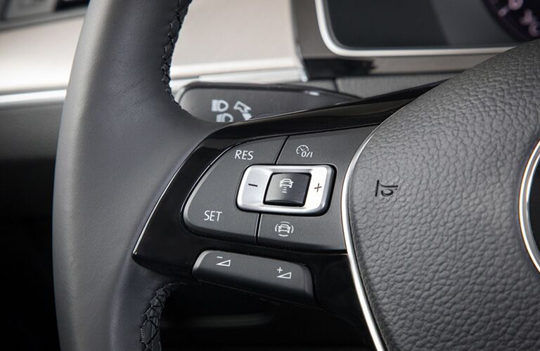 2019 VW Arteon interior close up of left side of steering wheel with control buttons