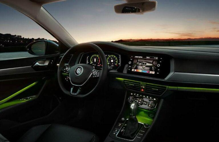 2019 Volkswagen Jetta front dash with green ambient lighting