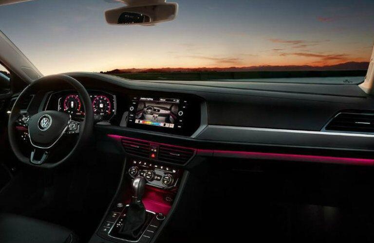 2019 Volkswagen Jetta front dash with pink ambient lighting
