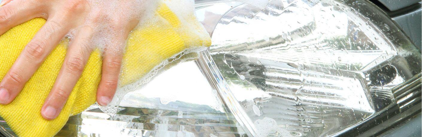 Freshly-polished headlight getting a final wash