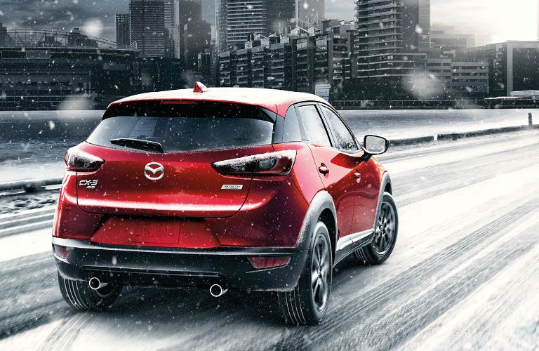 Rear End View of the 2017 Mazda CX-3 in Snow Showing AWD Ability